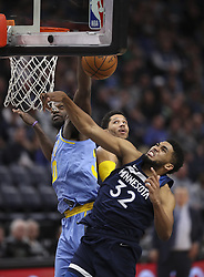 January 1, 2018 - Minneapolis, WI, U.S.A - Minnesota Timberwolves center Karl-Anthony Towns (32) had his fourth quarter dunk attempt blocked by Los Angeles Lakers forward Julius Randle. Towns finished with 16 points for the night.     ]  JEFF WHEELER • jeff.wheeler@startribune.com ....The Minnesota Timberwolves trounced the Los Angles Lakers 114-96 in a New Year's Day NBA game Monday night, January 1, 2018 at Target Center in Minneapolis. (Credit Image: © Jeff Wheeler/Minneapolis Star Tribune via ZUMA Wire)