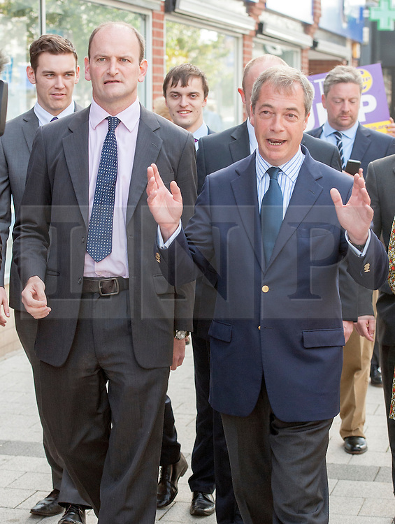 © Licensed to London News Pictures. 29/08/2014. Clacton-on-Sea, UK Douglas Carswell (L) and Nigel Farage, Leader of the UK Independence Party, UKIP, meet local people on a walk about in Clacton-on-Sea today 29th August 2014. Tory Douglas Carswell  defected to UKIP and quit as MP for Clacton, saying he will contest the subsequent by-election for Nigel Farage's party.. Photo credit : Stephen Simpson/LNP