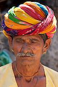 Indian man wearing traditional Rajasthani turban and gold earring in village of Nimaj, Rajasthan, Northern India
