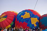 Hot air balloons being prepped to fly. Hot air Balloon Fiesta, October, 2010. Albuquerque, New Mexico, USA.