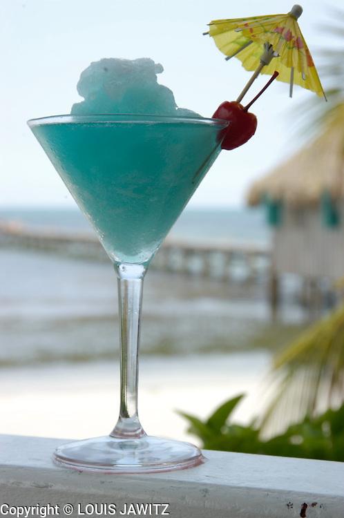 Daiquiri , tropical, drinks ,colorful, umbrella ,straw ,palm tree ,rum, punch, orange slice, shaved ice,