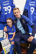 AFC Wimbledon striker Joe Pigott (39) and Mascot during the EFL Sky Bet League 1 match between AFC Wimbledon and Shrewsbury Town at the Cherry Red Records Stadium, Kingston, England on 14 September 2019.