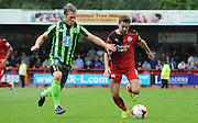 Gwion Edwards protecting the ball from Dannie Bulman during the Sky Bet League 2 match between Crawley Town and AFC Wimbledon at the Checkatrade.com Stadium, Crawley, England on 15 August 2015. Photo by Michael Hulf.