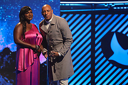 October 16, 2018 - Nashville, TN, U.S. - NASHVILLE, TN - OCTOBER 16: Deborah Joy Winans and Brian Courtney Wilson present an award during the 49th Annual Dove Awards on October 16, 2018, at Allen Arena in Nashville, TN. (Photo by Jamie Gilliam/Icon Sportswire) (Credit Image: © Jamie Gilliam/Icon SMI via ZUMA Press)