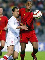 BRUXELLES BRUSSELS 28/04/2004 SPORT / FOOTBALL  VOETBAL / RODE DUIVELS - DIABLES ROUGES  / TURKEY - BELGIUM / VRIENDSCHAPPELIJKE WEDSTRIJD BELGIE - TURKIJE / MATCH AMICAL BELGIQUE - TURQUIE /<br /> HASAN GOKHAN - VINCENT KOMPANY<br /> / PICTURE JIMMY BOLCINA - PHILIPPE CROCHET - VINCENT KALUT ©PHOTO NEWS