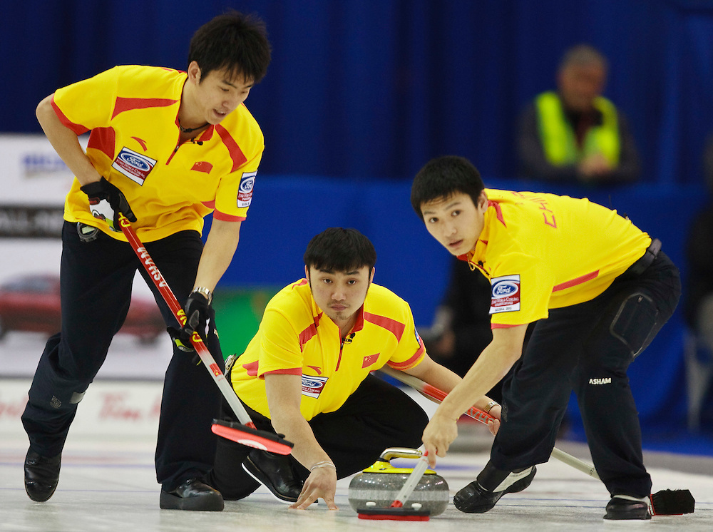 China's Skip Yansong Ji delivers his stone during the 10th end of their 5-4 loss to Canada at the World Curling Championships at the Brandt Centre in Regina, Saskatchewan, April 7, 2011.<br /> AFP PHOTO/Geoff Robins