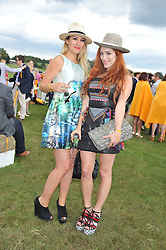 Left to right, EMMA SHERRY and JOANNA DELLA RAGIONE at the 2012 Veuve Clicquot Gold Cup Final at Cowdray Park, Midhurst, West Sussex on 15th July 2012.