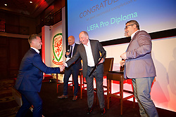 NEWPORT, WALES - Friday, May 18, 2018: Michael Flynn receives his UEFA Pro Licence Diploma from Lennie Lawrence (centre) and Wales technical director Osian Roberts (right) during day one of the Football Association of Wales' National Coaches Conference 2018 at the Celtic Manor Resort. (Pic by David Rawcliffe/Propaganda)