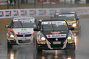 Wellington's Jamie Gaskin leads Taupo's Mark Gibson during the second race for the Suzuki Swift Sport Cup at the CRC 200 at Timaru International Motor Raceway on 22 January 2012. The CRC 200 is part of the New Zealand Premier Race Championship Series.
