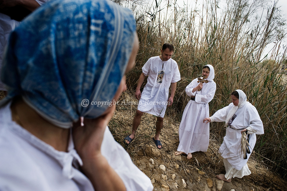 "JORDAN, BETHANY : Eastern European Christian Orthodox pilgrims stand close to Jordan river in Bethany on January 18, 2011, believed to be the biblical ""Bethany-beyond-the-Jordan"", where John the Baptist lived and Jesus was baptized. ALESSIO ROMENZI"
