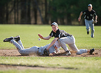 Gilford's Brandon Sasserson tags back to second base ahead of Prospect Mountain's Zach Bousquet during Friday afternoon NHIAA Division III baseball.   (Karen Bobotas/for the Laconia Daily Sun)