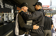 CHICAGO - SEPTEMBER 26:  Manager Rick Renteria #17 greets Jose Abreu #79 of the Chicago White Sox prior to the game against the Cleveland Indians on September 26, 2018 at Guaranteed Rate Field in Chicago, Illinois.  (Photo by Ron Vesely)  Subject: Ricky Renteria; Jose Abreu