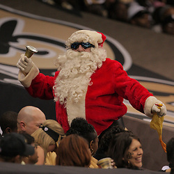 2008 December, 07: A New Orleans Saints fan dressed as Santa Claus dances in the stands during a 29-25 victory by the New Orleans Saints over NFC South divisional rivals the Atlanta Falcons at the Louisiana Superdome in New Orleans, LA.