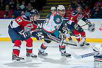 KELOWNA, CANADA -FEBRUARY 19: Parker Wotherspoon #37 of the Tri City Americans checks Madison Bowey #4 of the Kelowna Rockets as he takes a shot on net during the first period on February 19, 2014 at Prospera Place in Kelowna, British Columbia, Canada.   (Photo by Marissa Baecker/Getty Images)  *** Local Caption *** Parker Wotherspoon; Madison Bowey;
