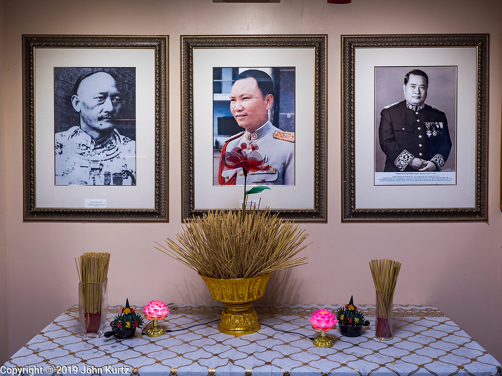 """03 AUGUST 2019 - ST. PAUL, MINNESOTA: A shrine dedicated to Hmong leaders in the Hmong Village, a Hmong market in St. Paul. The men honored are, Kiatong Lor Blia Yao, the first Hmong person to become a civil administrator in colonial French ruled Laos, General Vang Pao, a close ally of the US during the """"Secret War"""" in Laos and leader of the Hmong forces who fought with the US, and Phagna Damrong Ritthikai, Touby Lyfoung, a civil administrator in Laos after the French colonial period and before the communist victory in 1974. Thousands of Hmong people, originally from the mountains of central Laos, settled in the Twin Cities in the late 1970s and early 1980s. Most were refugees displaced by the American war in Southeast Asia. According to the 2010 U.S. Census, there are now 66,000 ethnic Hmong in the Minneapolis-St. Paul area, making it the largest urban Hmong population in the world. There are two large Hmong markers in St. Paul. The Hmongtown Marketplace has are more than 125 shops, 11 restaurants, and a farmers' market in the summer. Hmong Village is newer and has more than 250 shops and 17 restaurants.    PHOTO BY JACK KURTZ"""