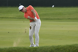 June 21, 2018 - Cromwell, CT, USA - Paul Casey hits his approach shot on the ninth hole during the first round of the Travelers Championship on Thursday, June 21, 2018 at TPC River Highlands in Cromwell, Conn. (Credit Image: © John Woike/TNS via ZUMA Wire)