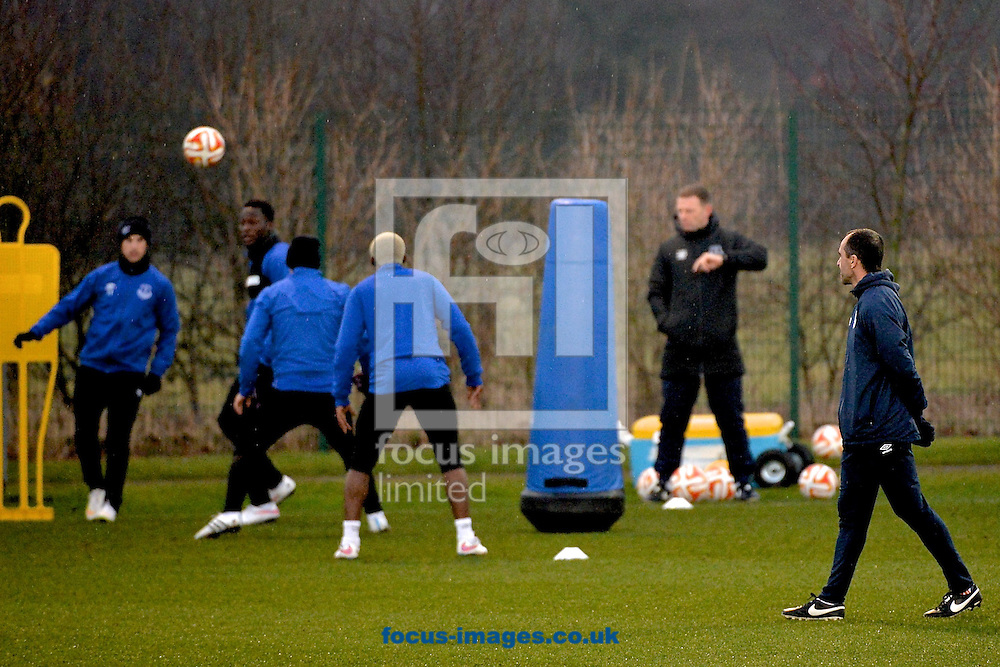 Everton manager Roberto Mart&iacute;nez (right) watches his players during the Everton training session prior to their  Europa League match against Dynamo Kyiv at Finch Farm, Liverpool<br /> Picture by Ian Wadkins/Focus Images Ltd +44 7877 568959<br /> 11/03/2015