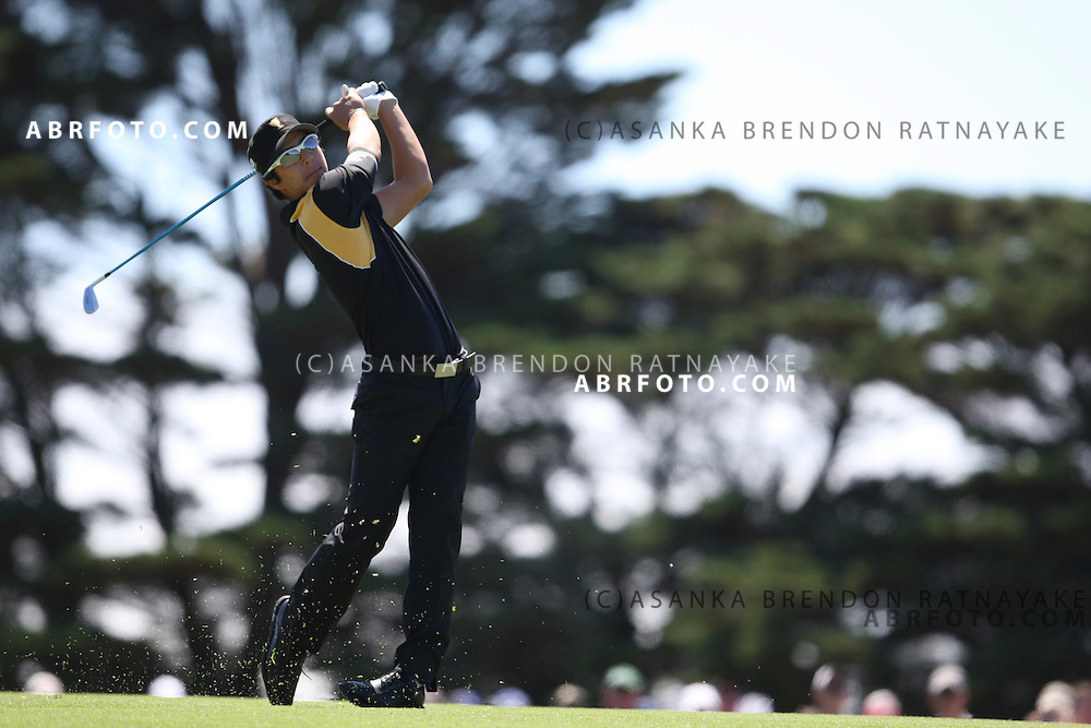 20 November 2011 : International Ryo Ishikawa plays an iron shot on the 2nd hole during the fifth-round Sunday Final round single ball matches at the Presidents Cup at the Royal Melbourne Golf Club in Melbourne, Australia. .