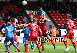 Rhys Bennett of Peterborough United jumps higher than Connor Johnson of Walsall to head the ball goalwards - Mandatory by-line: Joe Dent/JMP - 27/04/2019 - FOOTBALL - Banks's Stadium - Walsall, England - Walsall v Peterborough United - Sky Bet League One