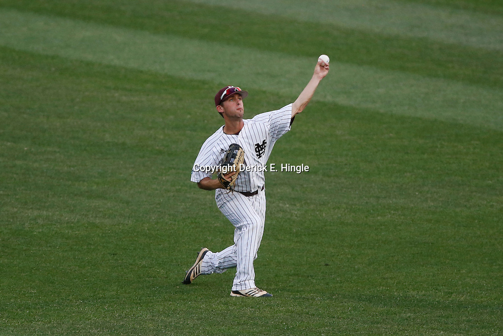 Jun 24, 2013; Omaha, NE, USA; Mississippi State Bulldogs center fielder C.T. Bradford (10) throws the ball in during the second inning in game 1 of the College World Series finals against the UCLA Bruins at TD Ameritrade Park. Mandatory Credit: Derick E. Hingle-USA TODAY Sports