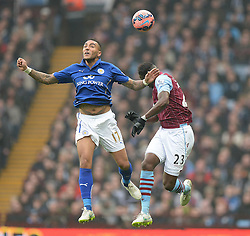 Leicester City's Danny Simpson wins a high ball over Aston Villas Aly Cissokho - Photo mandatory by-line: Alex James/JMP - Mobile: 07966 386802 - 15/02/2015 - SPORT - Football - Birmingham - Villa Park - Aston Villa v Leicester City - FA Cup - Fifth Round