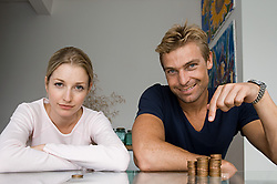 Dec. 14, 2012 - Couple with pile of coins (Credit Image: © Image Source/ZUMAPRESS.com)