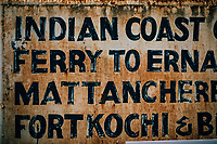 Fort Kochi, India -- February 12, 2018: A handpainted sign in the old town.