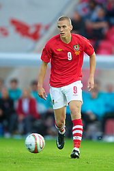 LLANELLI, WALES - Wednesday, August 11, 2010: Wales' Steve Morison in action on his debut against Luxembourg during an international friendly match at Parc y Scarlets. (Pic by David Rawcliffe/Propaganda)