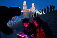 A tourist couple buying electronic gadgets in Harbin during the Ice festival.