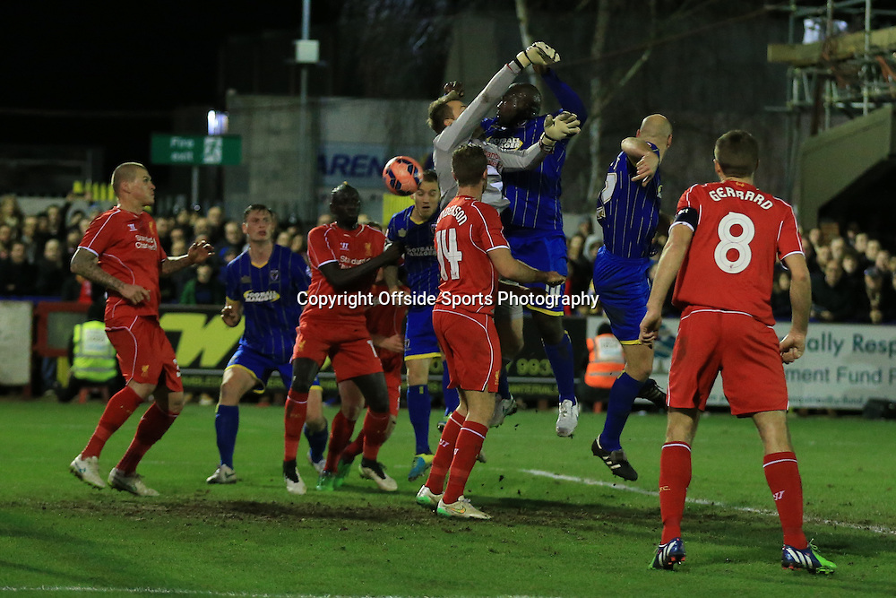 5 January 2015 - The FA Cup 3rd Round - AFC Wimbledon v Liverpool - Simon Mignolet of Liverpool fails to collect a cross leading to the Wimbledon equalising goal - Photo: Marc Atkins / Offside.