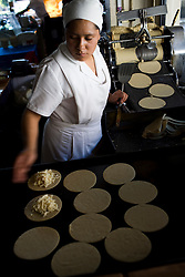 A woman makes hand made tortillas at El Bajio, a well known restaurant in Mexico City for traditional mexican cuisine.
