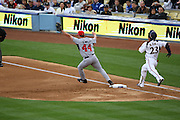 LOS ANGELES, CA - MARCH 22: Starting pitcher Roy Oswalt #44 of USA tags first base for the third out in the bottom of the first inning on a ground ball hit by Norichika Aoki #23 of Japan in game two of the semifinal round of the 2009 World Baseball Classic at Dodger Stadium in Los Angeles, California on Sunday March 22, 2009. Japan defeated USA 9-4. (Photo by Paul Spinelli/WBCI/MLB Photos) *** Local Caption *** Roy Oswalt;Norichika Aoki