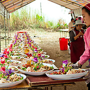 Caterers create colorful elaborate dishes in an assembly line at a wedding in Namasiya Township, Kaoshiung County, Taiwan