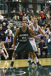 17 December 2011:  Alex Toth blocks out Kevin Reed during an NCAA mens division 3 basketball game between the Washington University Bears and the Illinois Wesleyan Titans in Shirk Center, Bloomington IL