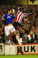 London - Tuesday, 21st September, 2010: Toumani Diagouraga of Brentford and Marouane Fellani of Everton during the Carling Cup 3rd Round match at Griffin Park, London...Pic by: Alex Broadway/Focus Images
