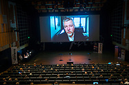 Event Photography images taken during the 2018 Podcast Day, held at The Black Diamond (Den Sorte Diamant) in Copenhagen, Denmark. <br /> <br /> An audience watches a video presentation.  <br /> <br /> © Event Photographer in Copenhagen Matthew James
