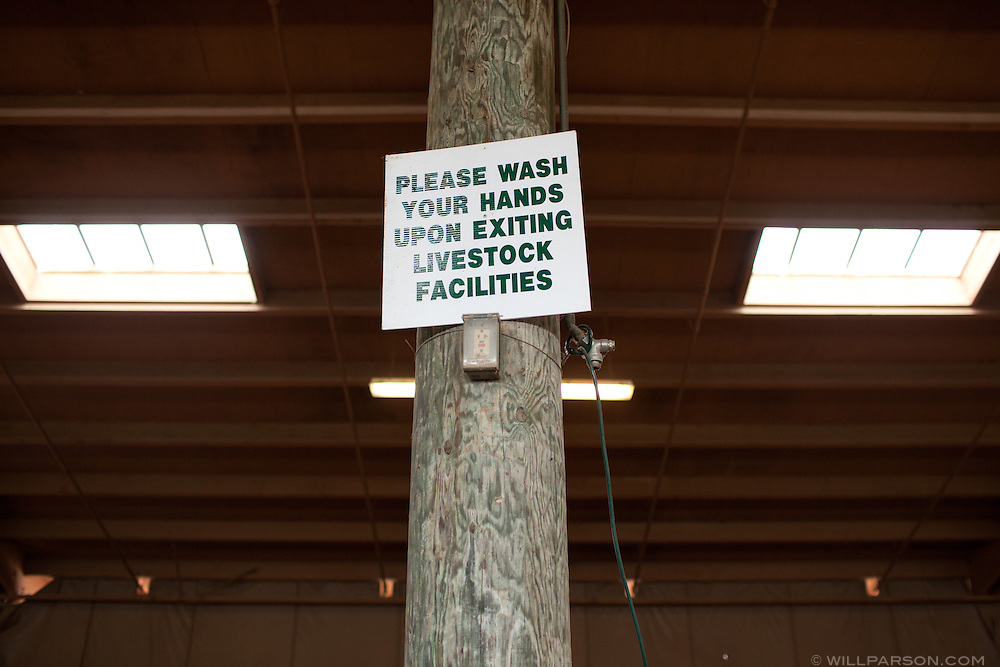 A sign urges visitors to wash their hands in the goat exhibit.