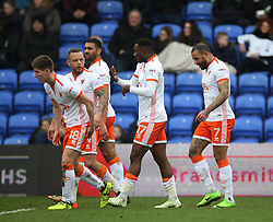 Kyle Vassell of Blackpool (R) celebrates scoring his sides first goal - Mandatory by-line: Jack Phillips/JMP - 02/04/2018 - FOOTBALL - Sportsdirect.com Park - Oldham, England - Oldham Athletic v Blackpool - Football League One