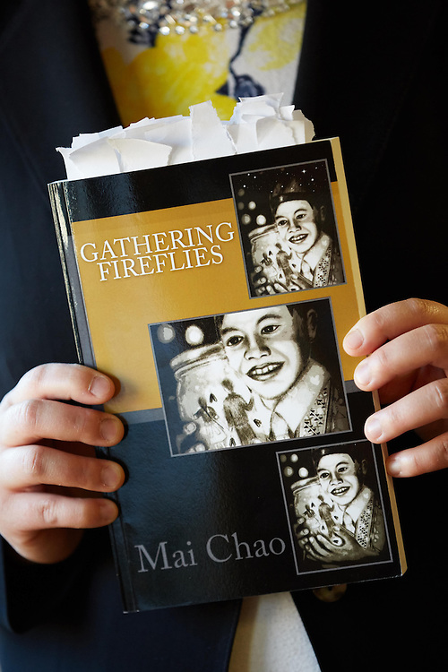 Activity; Art; Speaking; Teaching; Location; Classroom; Inside; Objects; Books; Projector; People; Alumni; Woman Women; Spring; May; Type of Photography; Candid; UWL UW-L UW-La Crosse University of Wisconsin-La Crosse; Mai Chao presents her book Gathering Fire Flies to Logan Middle School Students