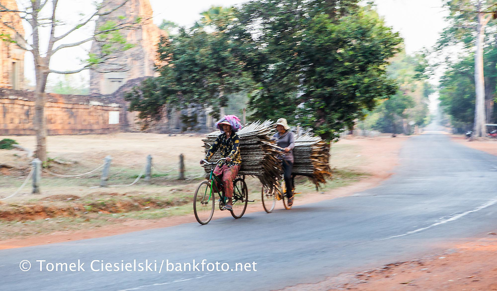 Villagers riding on market