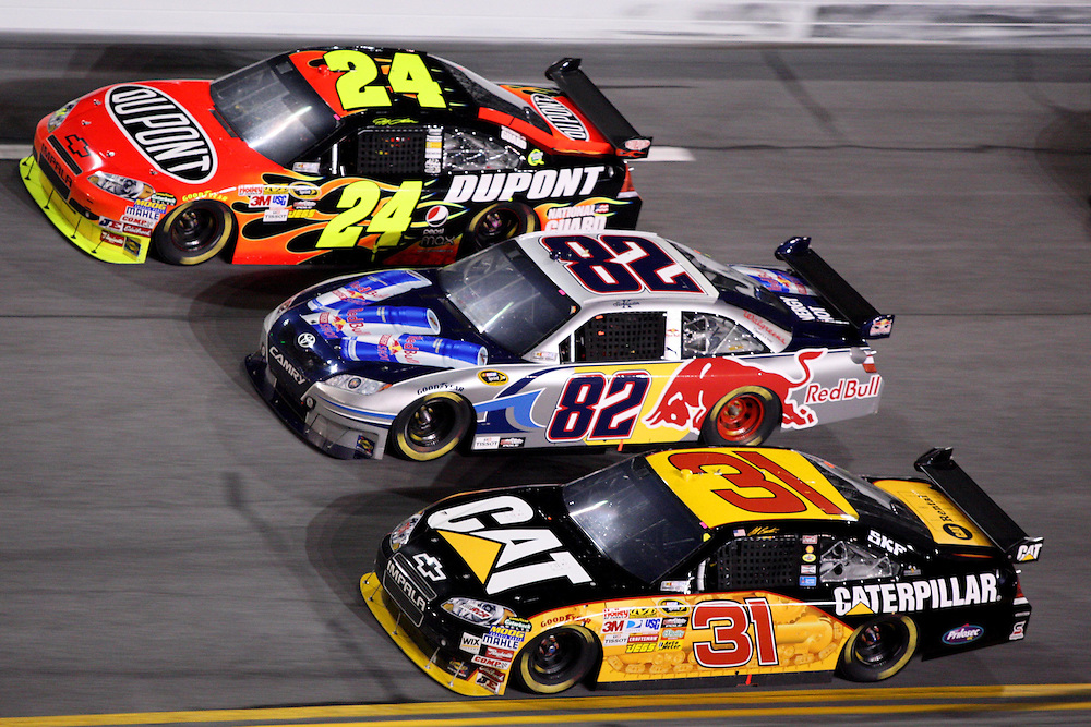 Feb 6, 2010; Daytona Beach, FL, USA; NASCAR Sprint Cup Series driver Jeff Burton (31), Ken Schrader (82) and Jeff Gordon (24) battle for position in turn four during the Bud Shootout at the Daytona International Speedway. Mandatory Credit: Douglas Jones-