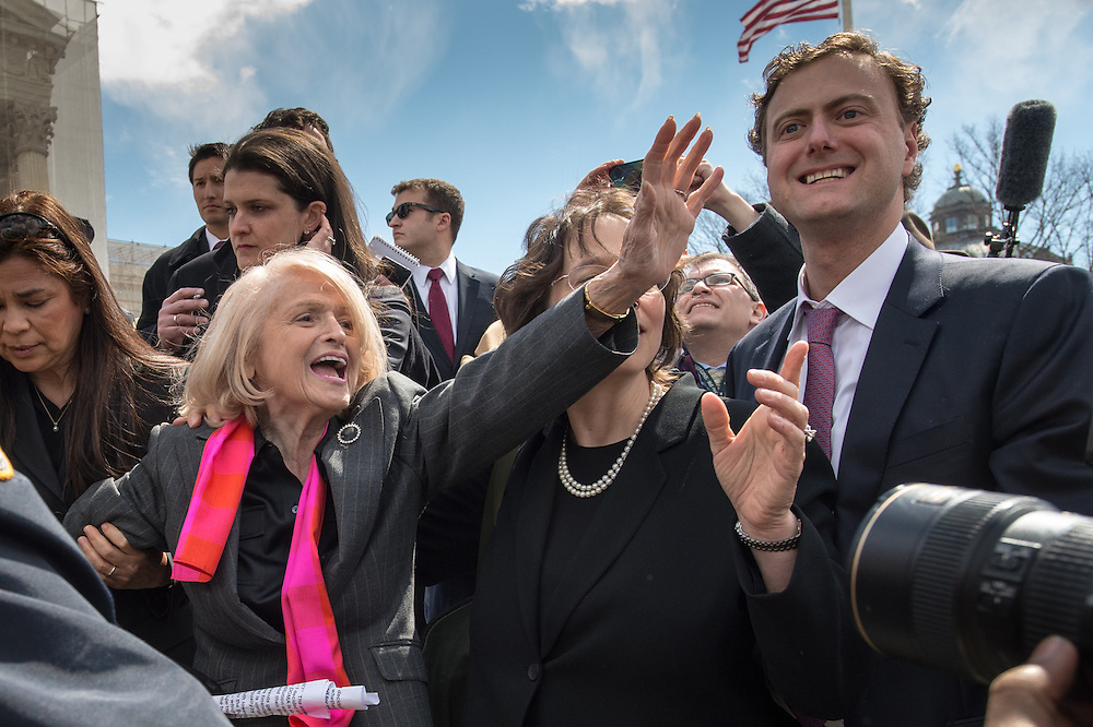 Edith Windsor, 83, shows her love for her supporters as she leaves the Supreme Court Wednesday March 27, 2013 in Washington, DC.  Oral arguments were heard at the Supreme Court in the case of 'Edith Schlain Windsor, in Her Capacity as Executor of the Estate of Thea Clara Spyer, Petitioner v. United States,' that challenges the constitutionality of the Defense of Marriage Act (DOMA). Photo Ken Cedeno