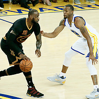 12 June 2017: Golden State Warriors forward Andre Iguodala (9) defends on Cleveland Cavaliers forward LeBron James (23) during the Golden State Warriors 129-120 victory over the Cleveland Cavaliers, in game 5 of the 2017 NBA Finals, at the Oracle Arena, Oakland, California, USA.