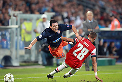 Remi Cabella of Montpellier is fouled by Kieran Gibbs during the Champions League group match between Montpellier and Arsenal at the Stade la Mosson, Montpellier, France, 18th September 2012. Eoin Mundow/Cleva Media