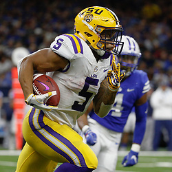 Sep 2, 2017; New Orleans, LA, USA; LSU Tigers running back Derrius Guice (5) runs against the Brigham Young Cougars during the second quarter of the AdvoCare Texas Kickoff game at the Mercedes-Benz Superdome. Mandatory Credit: Derick E. Hingle-USA TODAY Sports