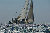 Crew members on board yacht competing in team sailing event California