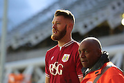 Bristol City defender Nathan Baker leaves the pitch after being shown a red card during the Sky Bet Championship match between Bristol City and Blackburn Rovers at Ashton Gate, Bristol, England on 5 December 2015. Photo by Jemma Phillips.