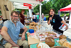 Geoff Crowe of Breadshare, an exhibitor at Social in the Gardens, a two-day open air festival in Princes Street Gardens, Edinburgh hosted by former Britain's Got Talent contestant Anna Devitt (right). Pic copyright Terry Murden @edinburghelitemedia