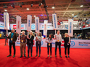 14 JANUARY 2020 - DES MOINES, IOWA: Debate volunteers wait in the spin room with placards for the candidates at the end of the CNN Democratic Presidential Debate on the campus of Drake University in Des Moines. This is the last debate before the Iowa Caucuses on Feb. 3.    PHOTO BY JACK KURTZ