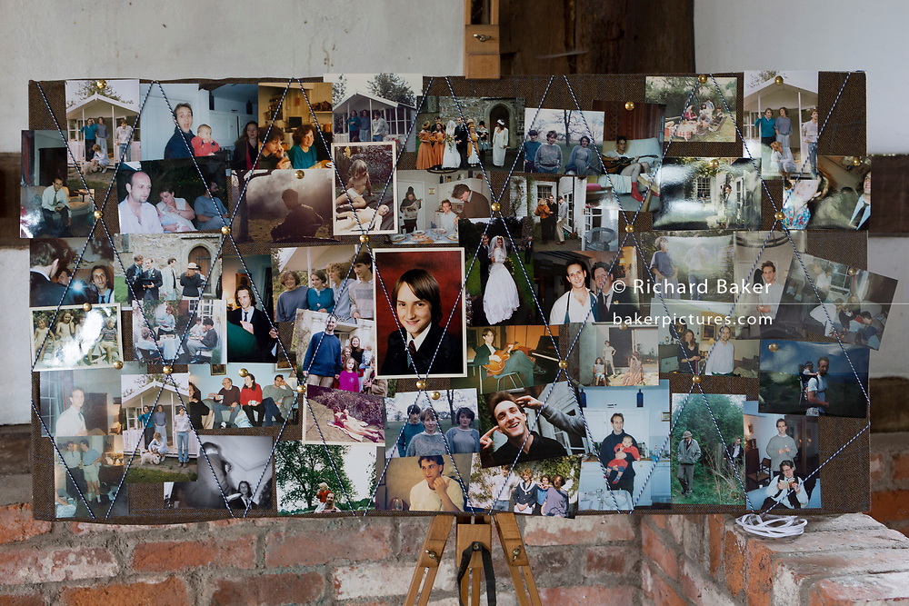 A lifetime of photos on a memory board for a man's 50 years from childhood to middle-age the morning after the morning after his 50th birthday party, in the Herefordshire countryside, on 23rd June 2019, in Kington, Herefordshire, England.